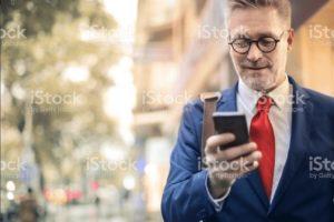 Man receiving SMS