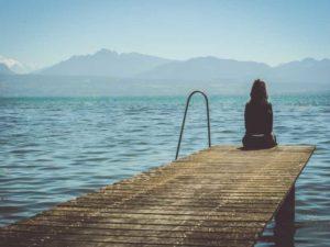 girl sitting on edge of jetty